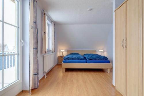 Schlafzimmer I – Ferienhaus Dornbusch